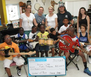 Bahama Village Music Program Executive Director Katchen Duncan, BVMP Teacher/Musician Nick Norman, CFFK Grant Committee Chair Ann Reynolds, BVMP Teacher/Musician Larry Baeder, BVMP Program Director Kate Divoll, with music students.