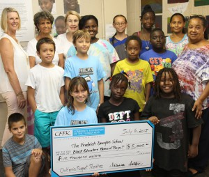 (Back, from left) CFFK President Dianna Sutton, Frederick Douglass School Project Facilitator Dr. Virginia Burgohy Irving, CFFK Grant Committee Chair Ann Reynolds, with students and Project Secretary Detra Fisher (far right)