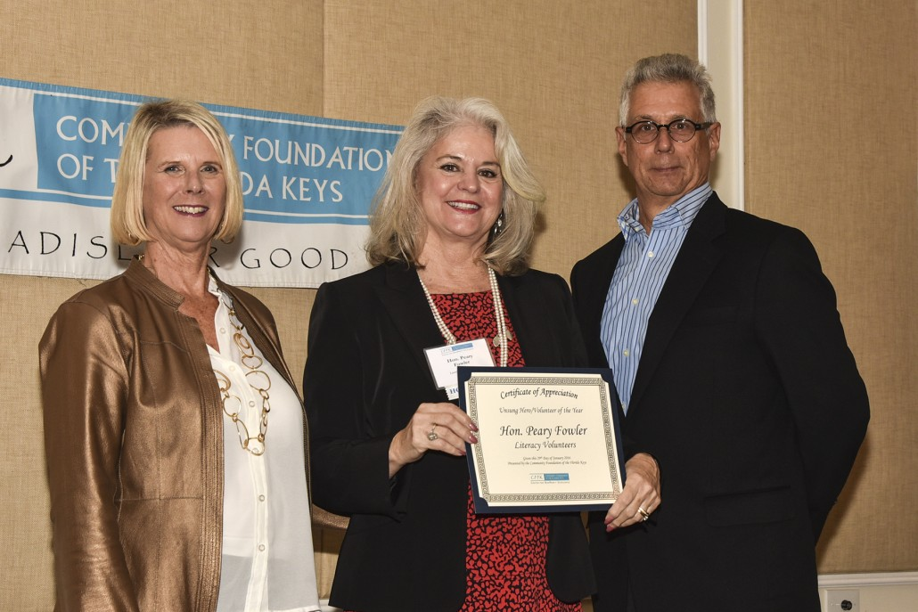 2016 Unsung Hero Honorable Peary Fowler of Literacy Volunteers (center) with CFFK President/CEO Dianna Sutton and Chairman Roger Heinen.