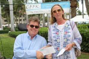 Thomas Callahan receives Star of the Sea Outreach Mission's 2016 Health and Human Services grant from Community Foundation Special Advisor Holly Merrill.