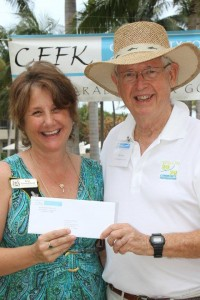 Kim Youngblood receives Zonta Club of Marathon's 2016 Health and Human Services grant from Community Foundation Board Member Bill Porter.