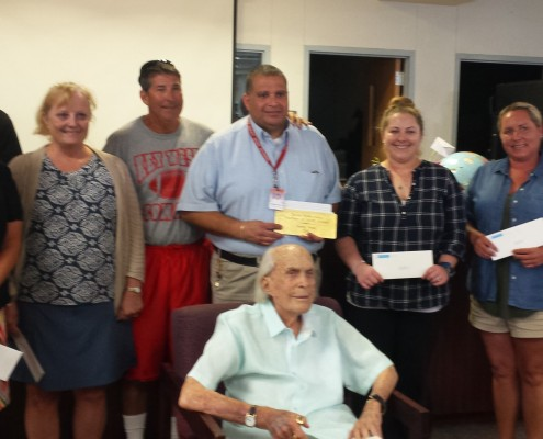 Left to right: Tracy Culiver, Dennis Whaley (in back), Jane McGill, Judd Wise, Henry Boza, Kaci Sublette, Tami Dannacker, and Raymond Archer, with Mr. Wolkowsky (seated). Not pictured: James Forbus.