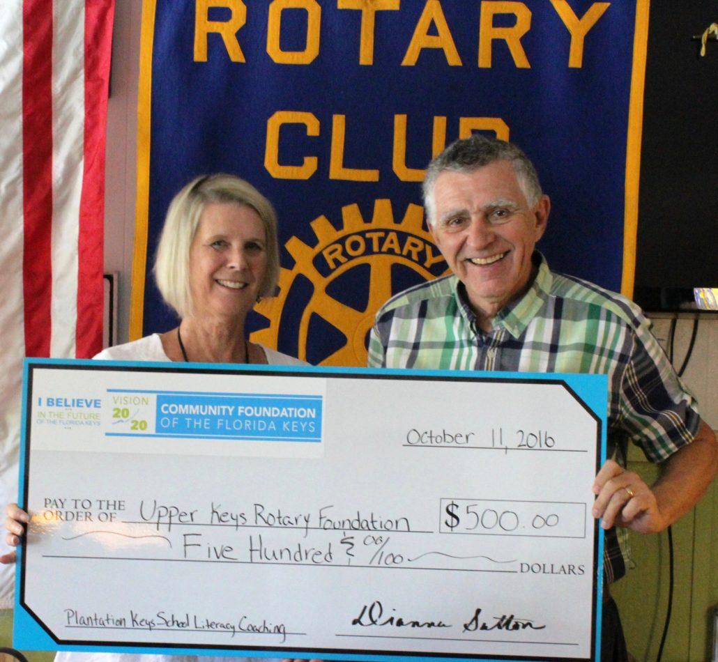 CFFK President/CEO Dianna Sutton congratulates Frank Derfler of the Upper Keys Rotary Foundation.