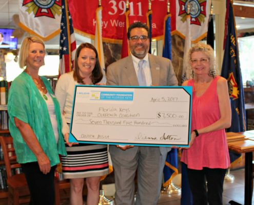 President/CEO Dianna Sutton (far left) and Grant Committee Chair Rita Linder (far right) present a grant check to Florida Keys Outreach Coalition's COO Stephanie Kaple and Board Chair Sam Kaufman.