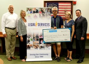 Legal Services of Greater Miami receives a CFFK grant check. From left, Attorney Don Yates, President/CEO Dianna Sutton, Chair Roger Heinen, Vice Chair Ann Reynolds, and Attorney Jose Fons.