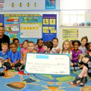 Grant recipient Wesley House Family Services: Jeremy Wilkerson (back row, left) and CFFK Grant Committee Chair Rita Linder (front, right) with kids from the Inez Martin Childcare Center.